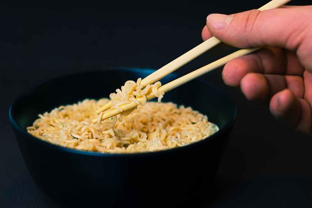 hand-eating-chopsticks-food-74153.jpeg